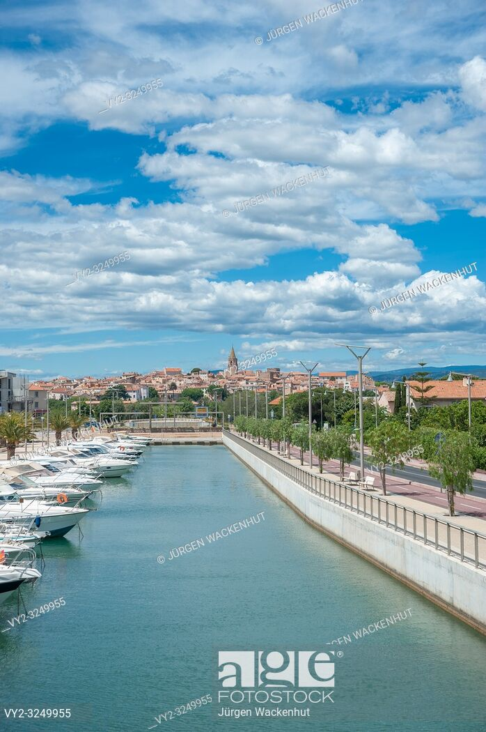 Marina of Port Frejus with old town in background Frjus Var 698x1050