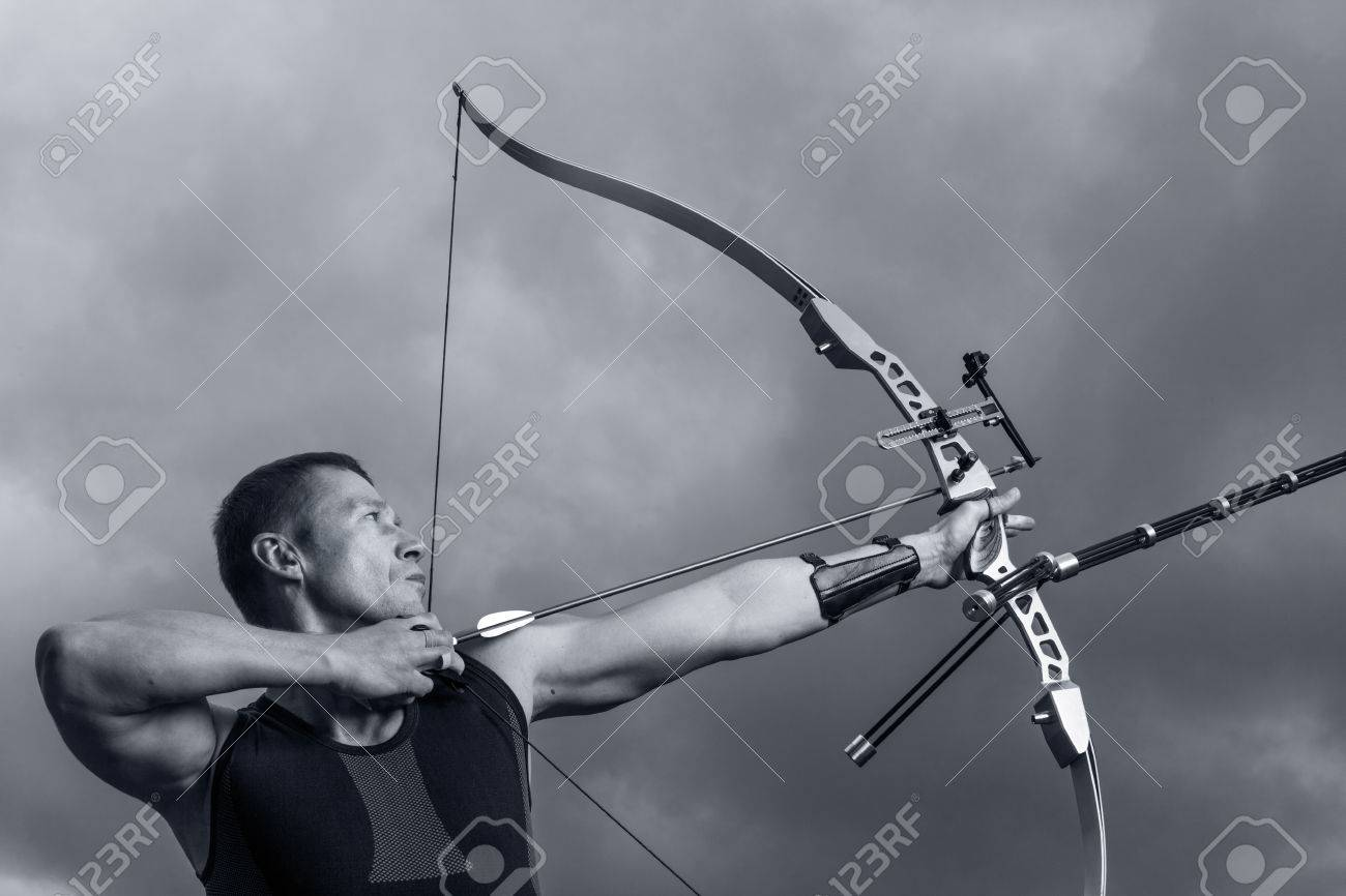 Tough Man With Bow And Arrows Close Up With Cloudy Sky At 1300x866