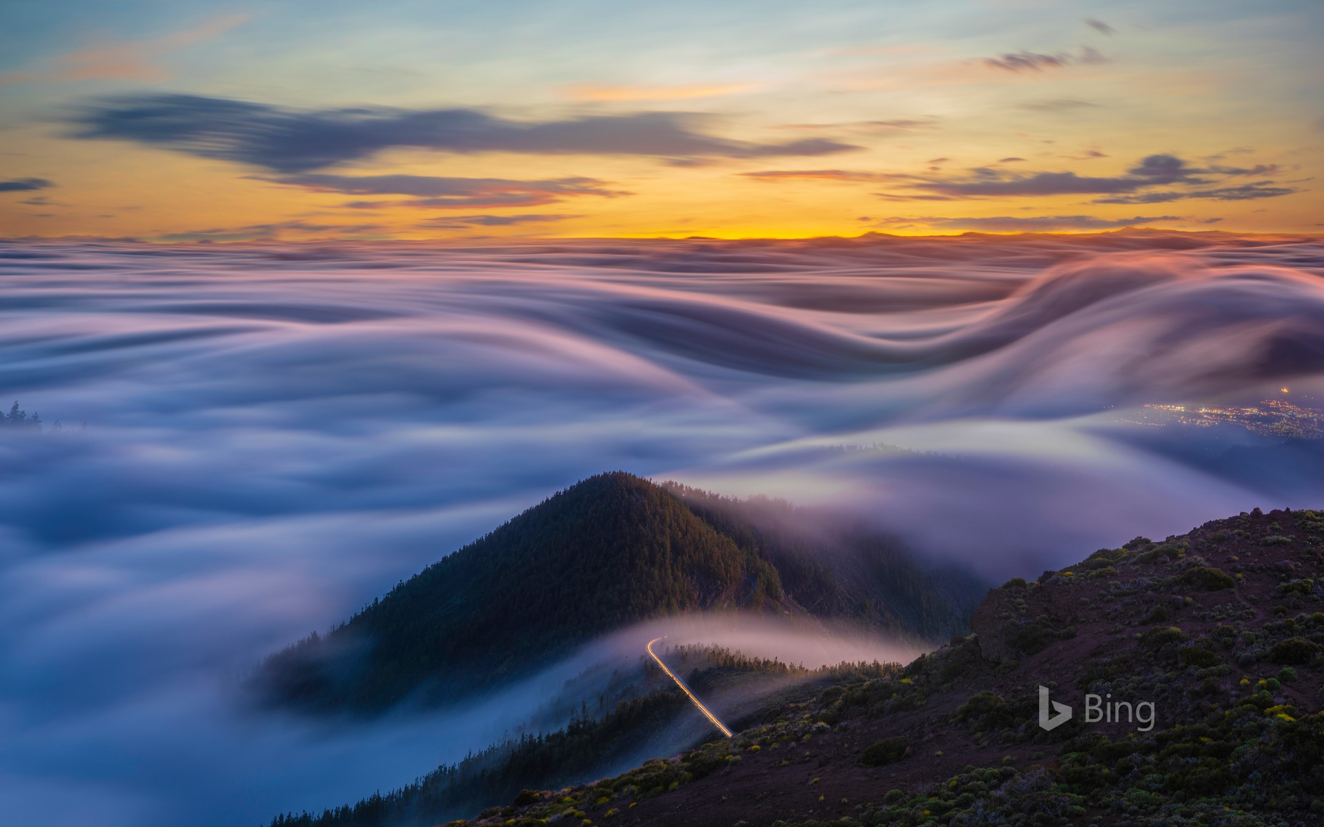 Clouds flowing over the mountains of Tenerife Canary Islands 1920x1200