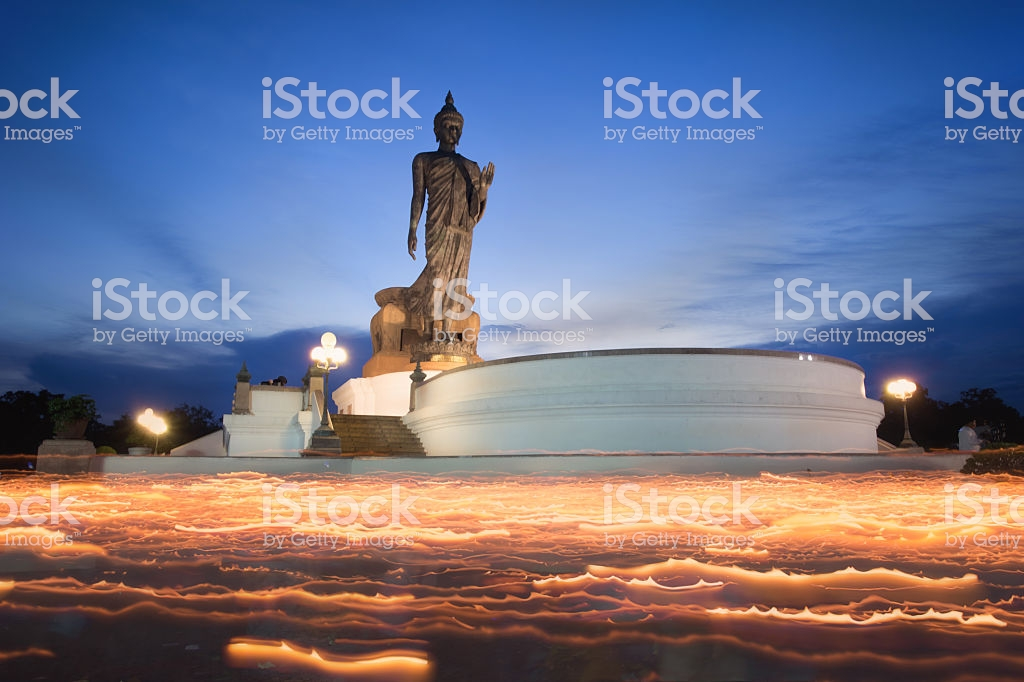 Buddha Statue Candle Lit In Lent Day Stock Photo   Download Image 1024x682