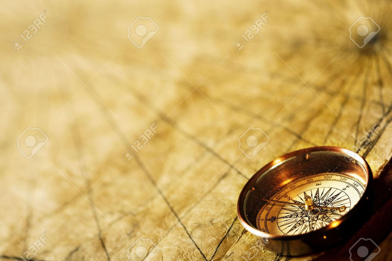 Close Up View Of The Compass On The Old Paper Background Stock 1300x866
