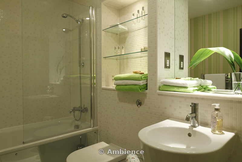 Ambience Images Mosaic tiled bathroom with stripy green wallpaper 800x534