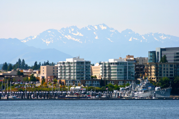 view of Bremerton with the Olympic Mountains towering behind the 611x408