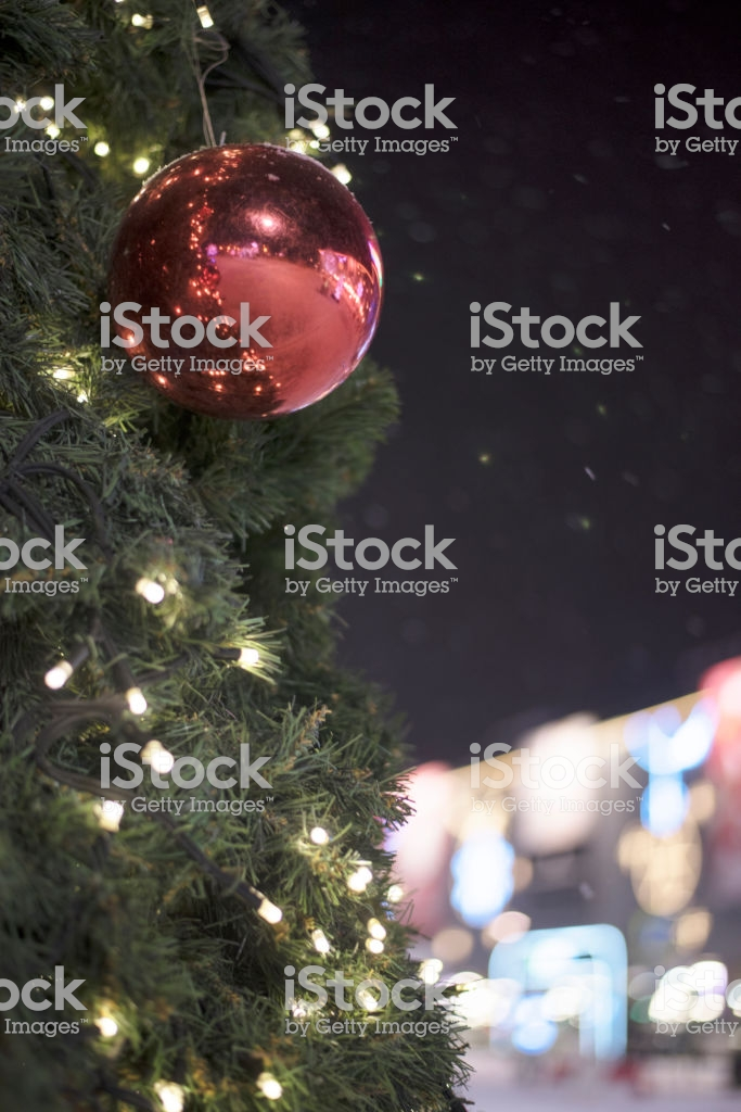 Red Christmas Ball And Garland On The Tree In The Background Is A 683x1024
