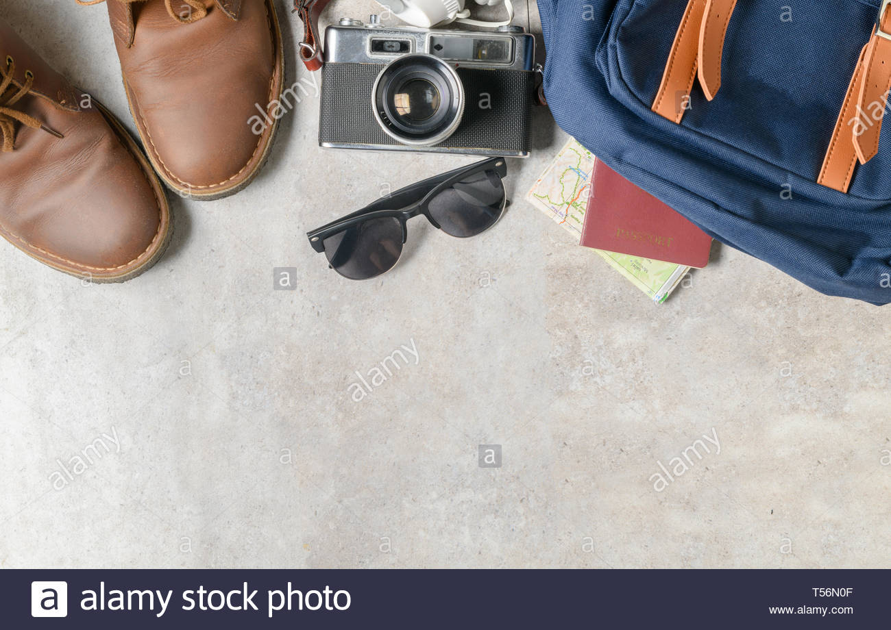 prepare backpack accessories and travel items on marble background 1300x920