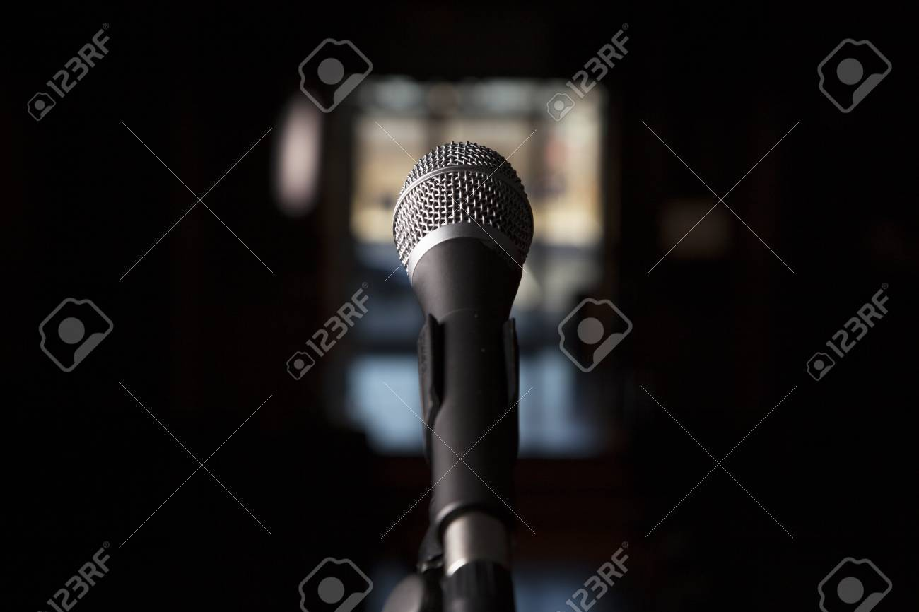 A Microphone Is Shown Alone With A Blurred Bocca Background Stock 1300x866