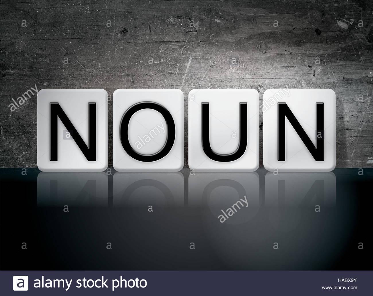 The word Noun written in white tiles against a dark vintage 1300x1035