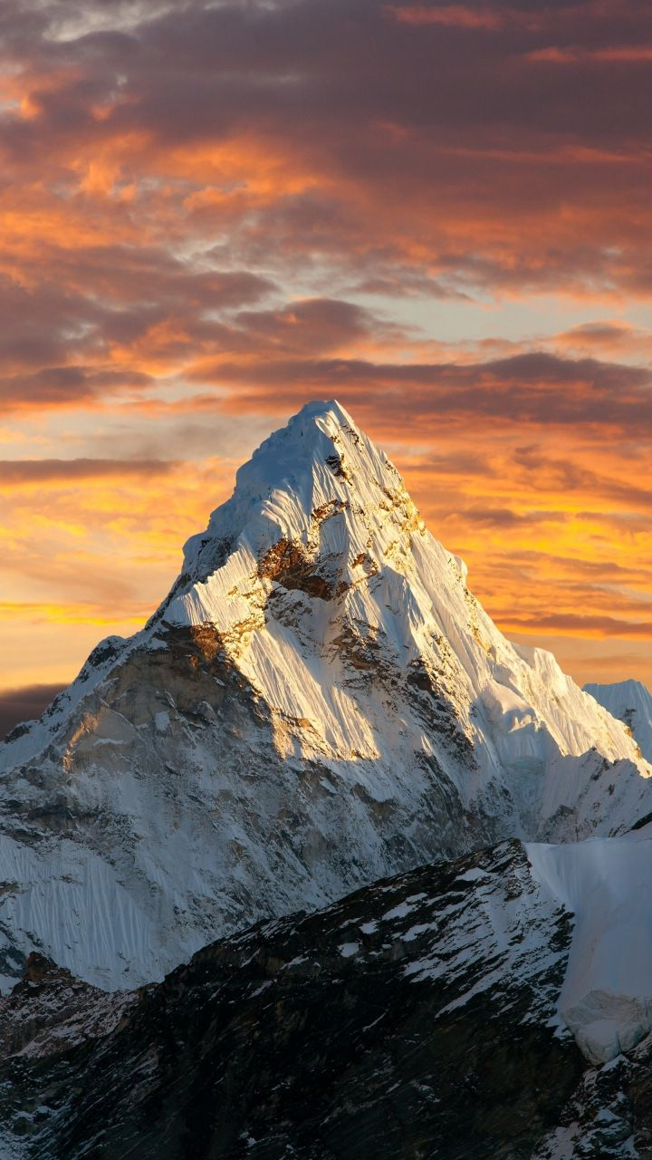 Sunset clouds sky mountains peak 720x1280 wallpaper 720x1280