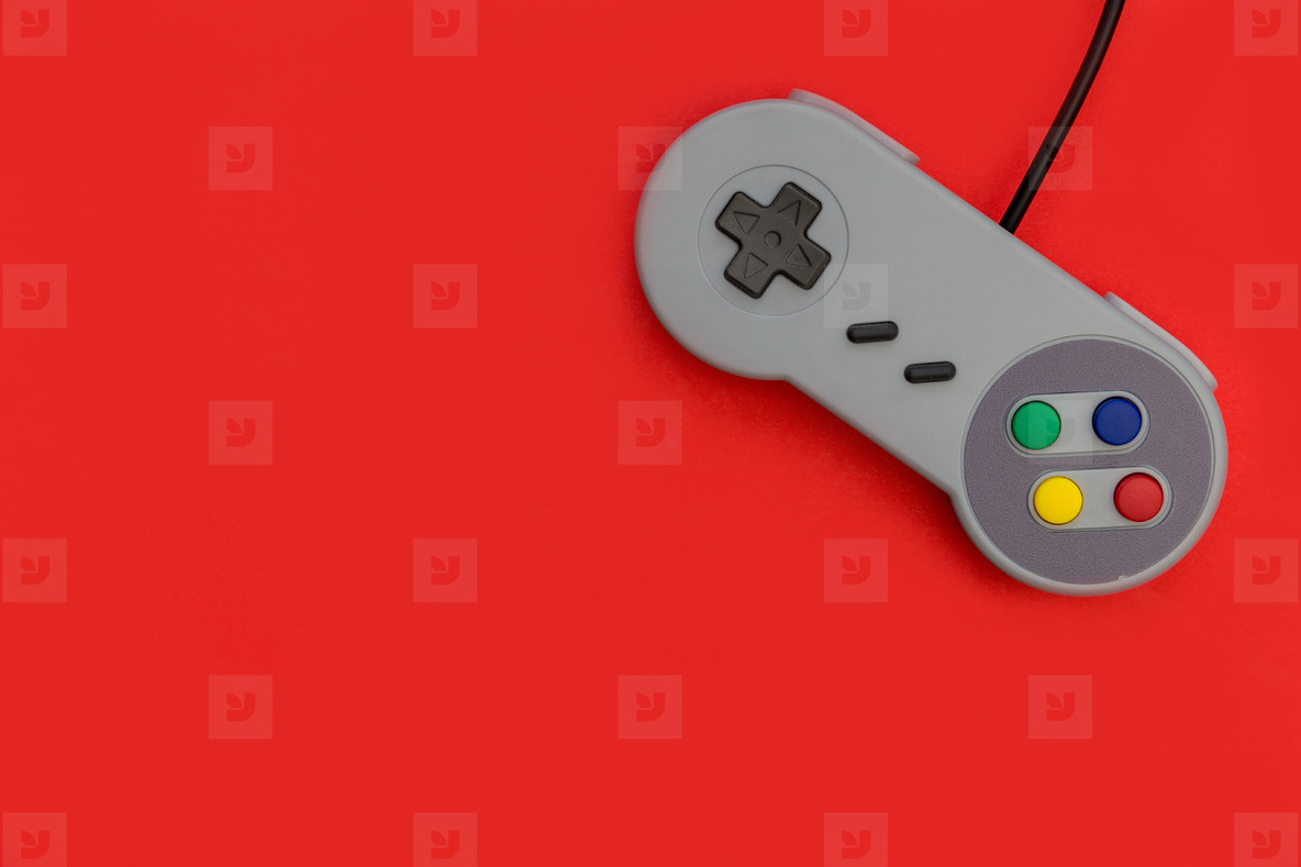 Photos   Retro video game controller red background   YouWorkForThem 1184x789