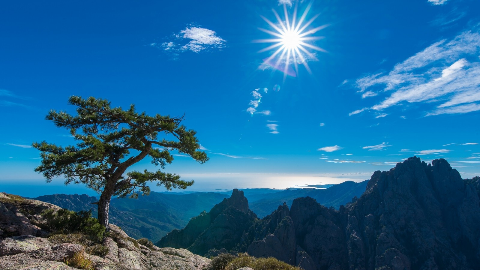 Sun Shining on Mountains in Corsica France Wallpaper and 1600x900