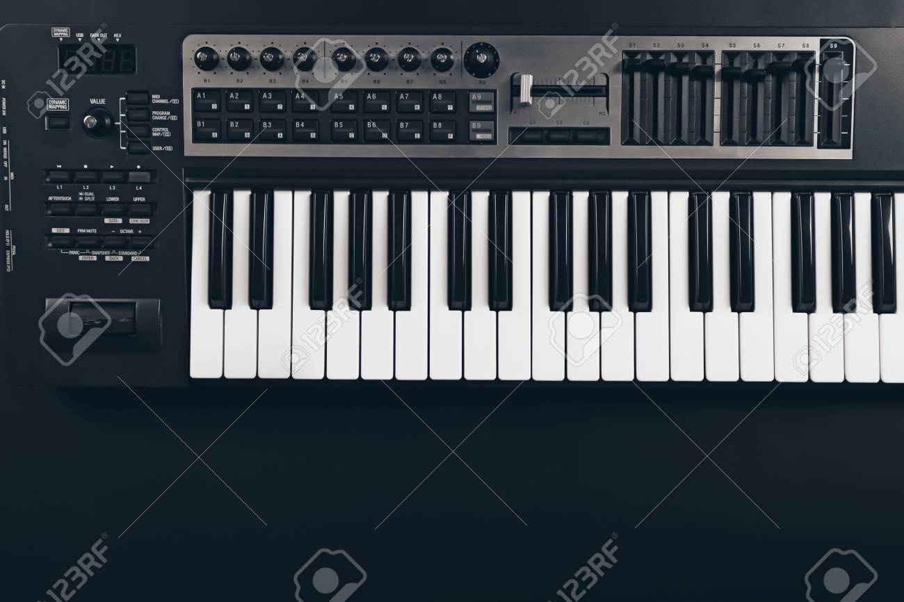 Keyboard Of Synthesizer On Black Background Stock Photo Picture 1300x866