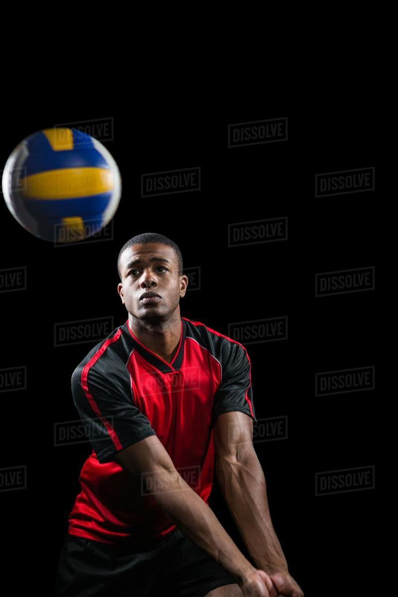 Sportsman playing a volleyball on black background   Stock Photo 800x1200