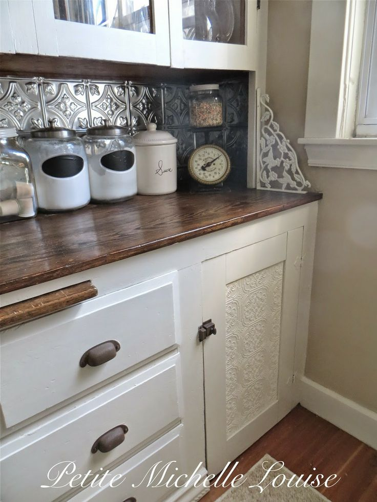 add wallpaper to cabinet doors and paint it white Would make painting 736x981