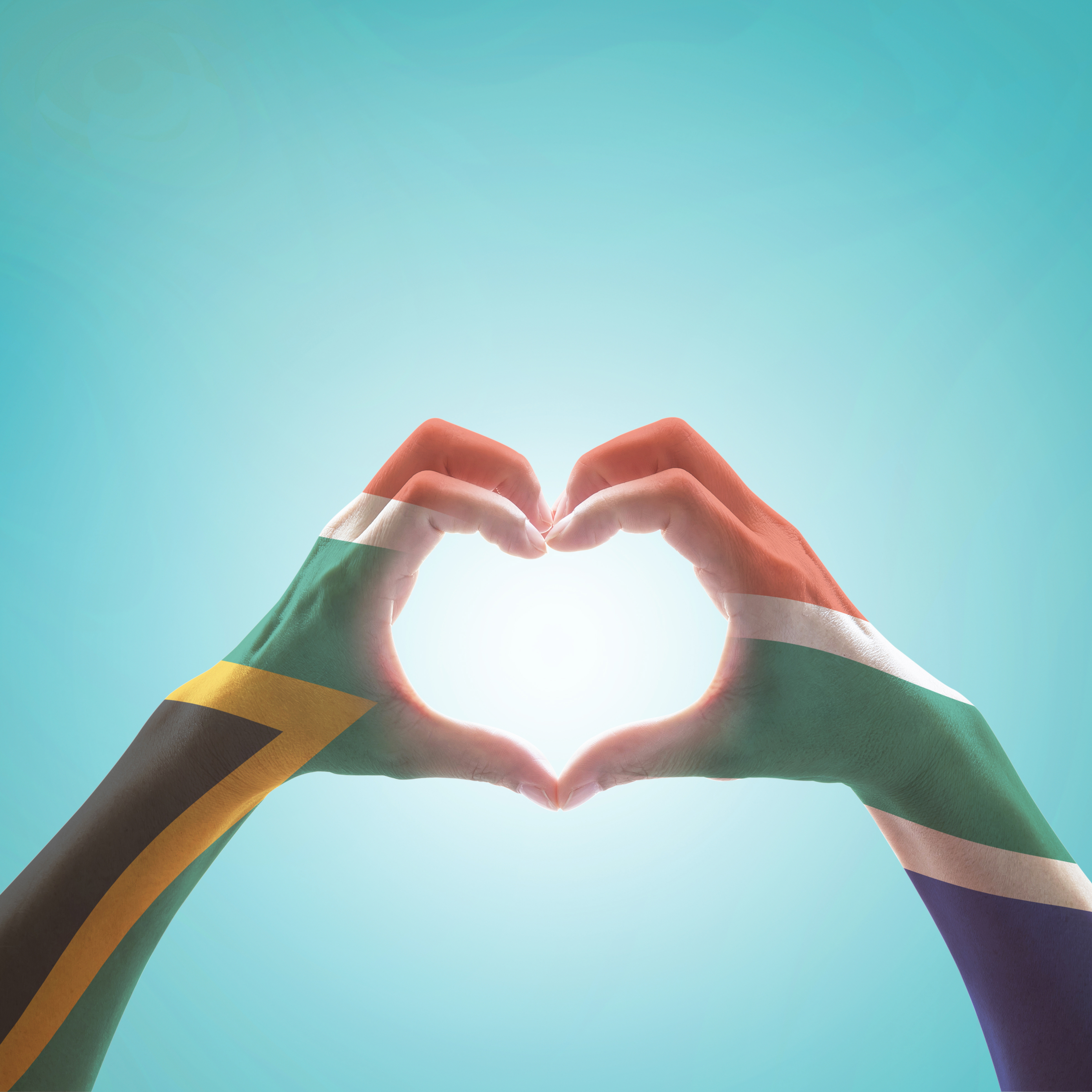South Africa flag on woman hands in heart shape isolated on mint 3956x3956