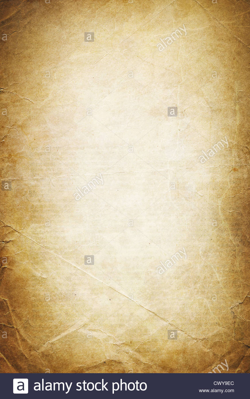 Vintage folded and torn old paper Grunge classic background Stock 871x1390