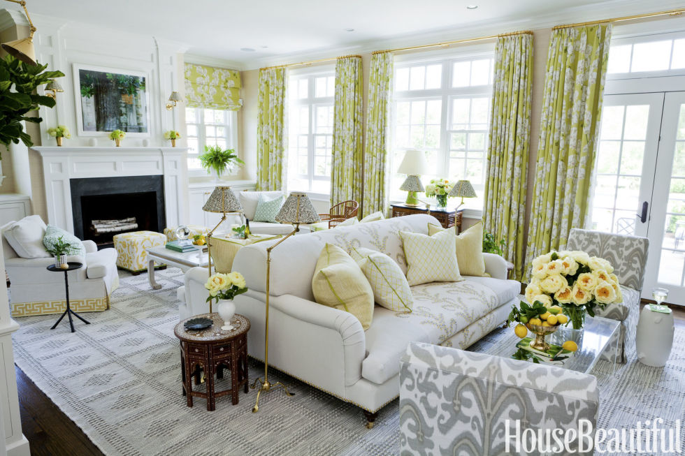 In the family room a custom two sided sofa defines separate seating 980x653