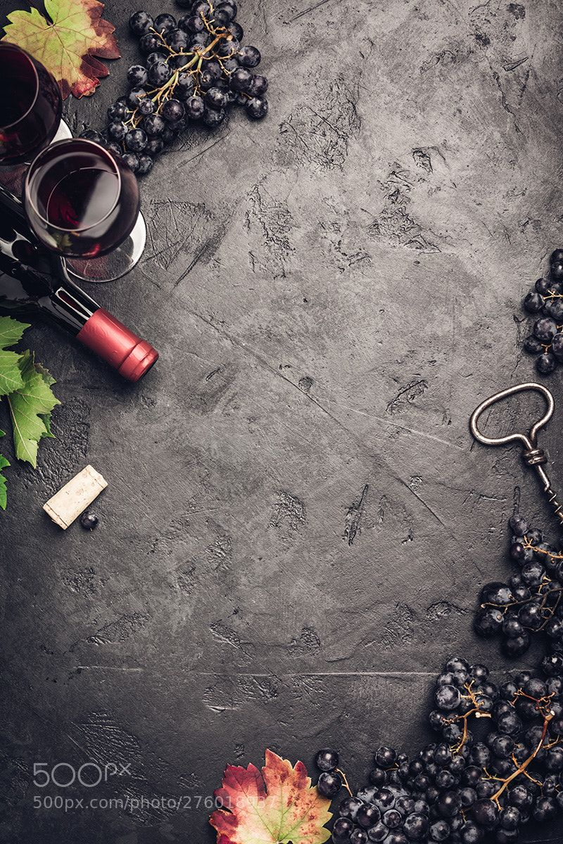 Wine composition on dark rustic background Wine with grapes leaves 800x1200