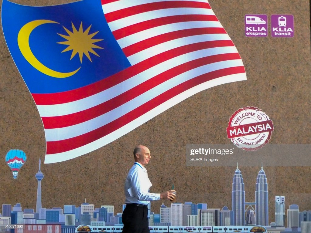 A foreigner is seen with a Malaysia flag as a background Kuala 1024x768