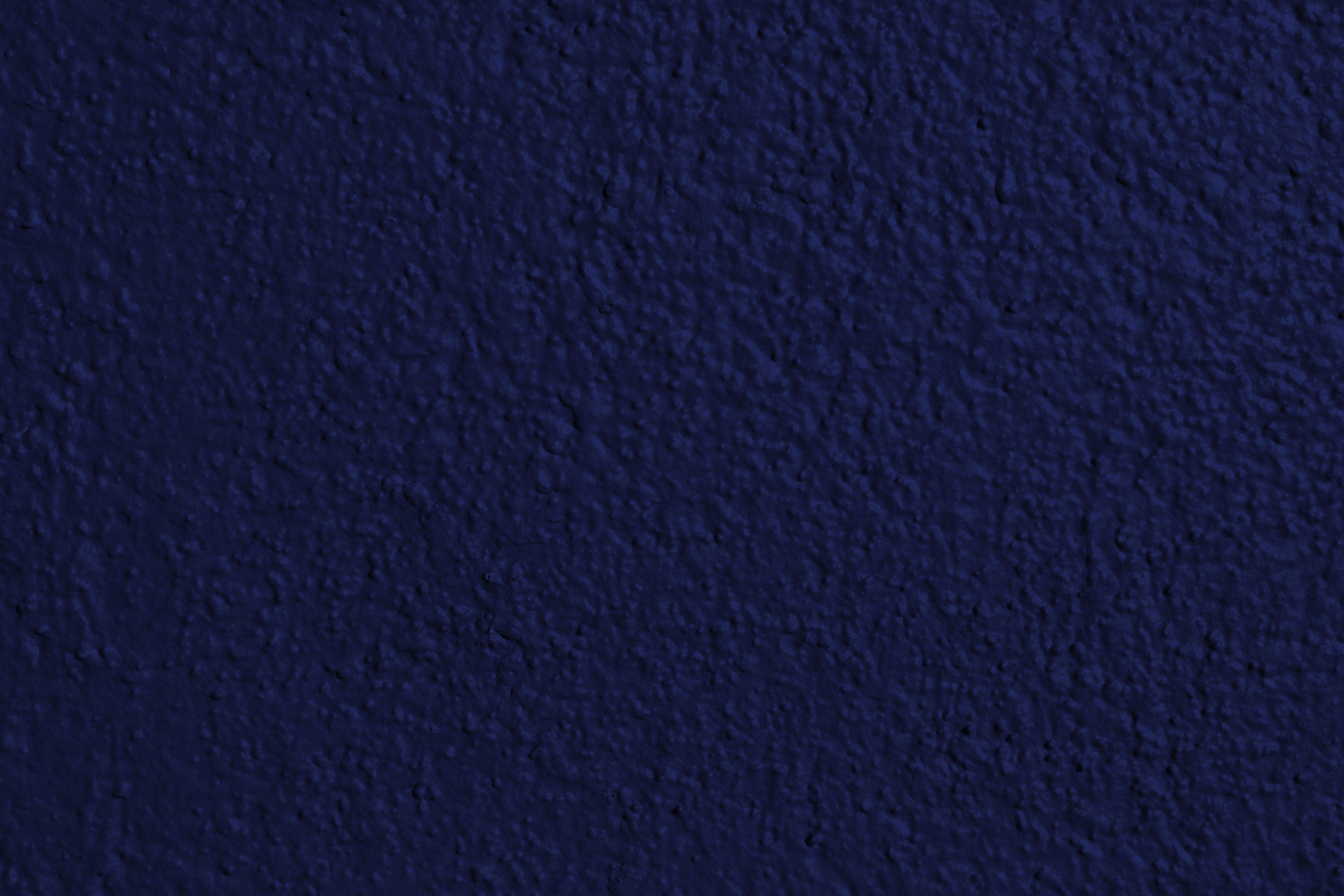 X on wall paint dark blue