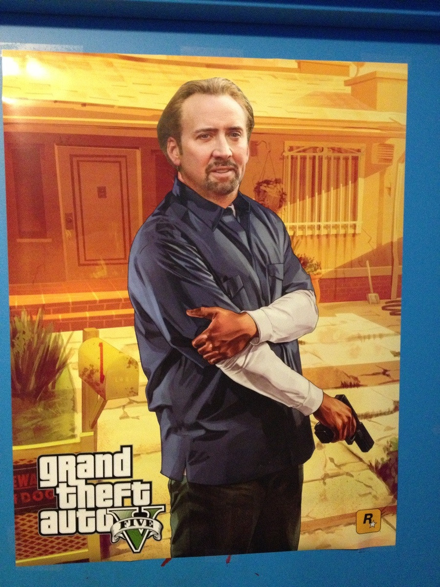 game store near me puts Nicolas Cage faces on many posters 900x1200