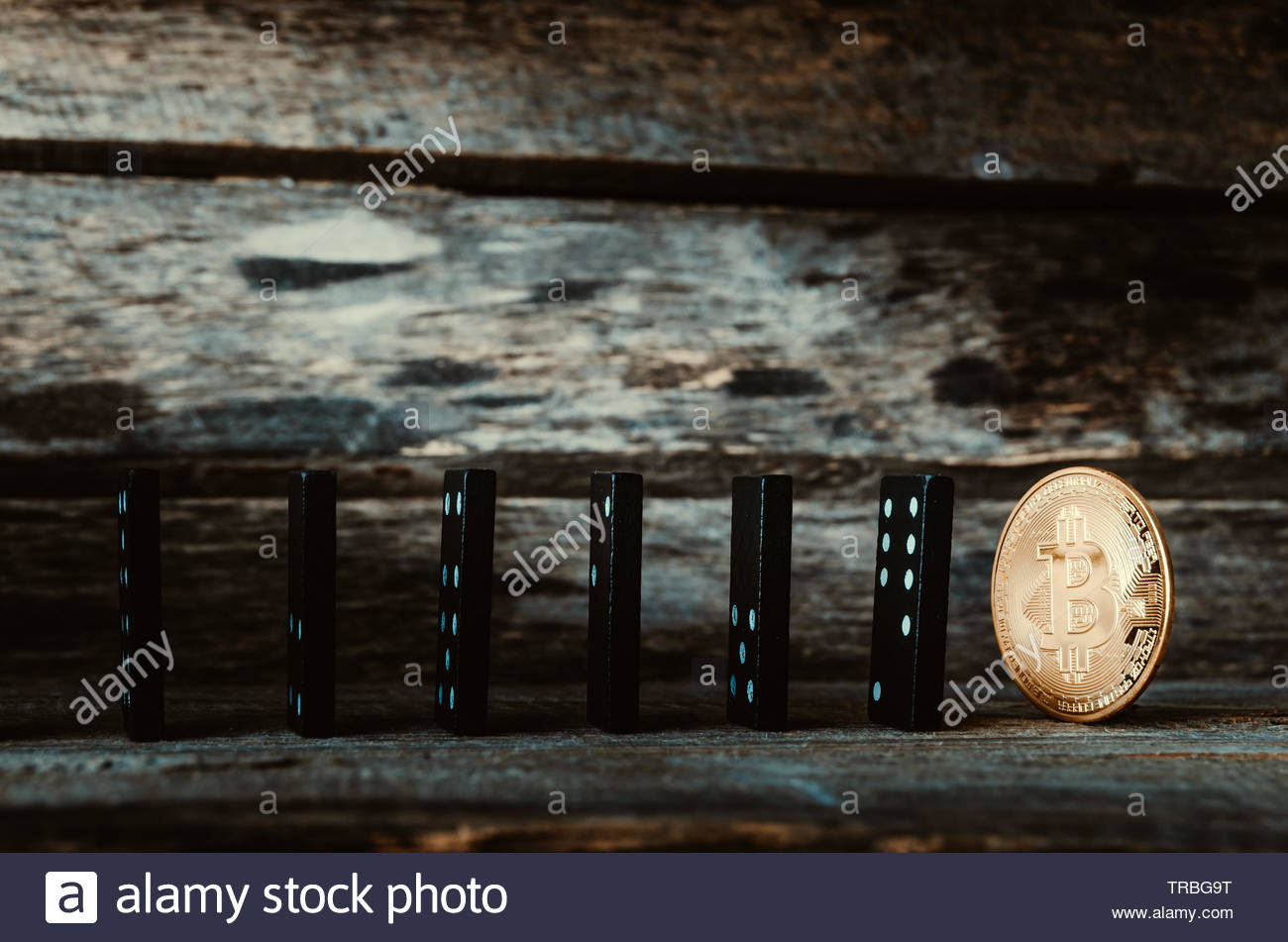 Domino and bitcoin coin on wooden background Crash Finance 1300x951