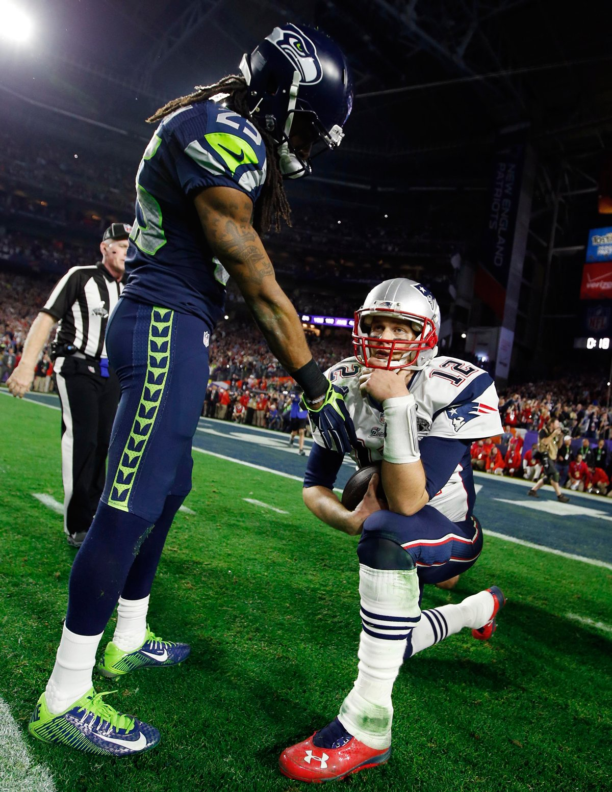 An awesome photo of Richard Sherman and Tom Brady on the last play of 1200x1554