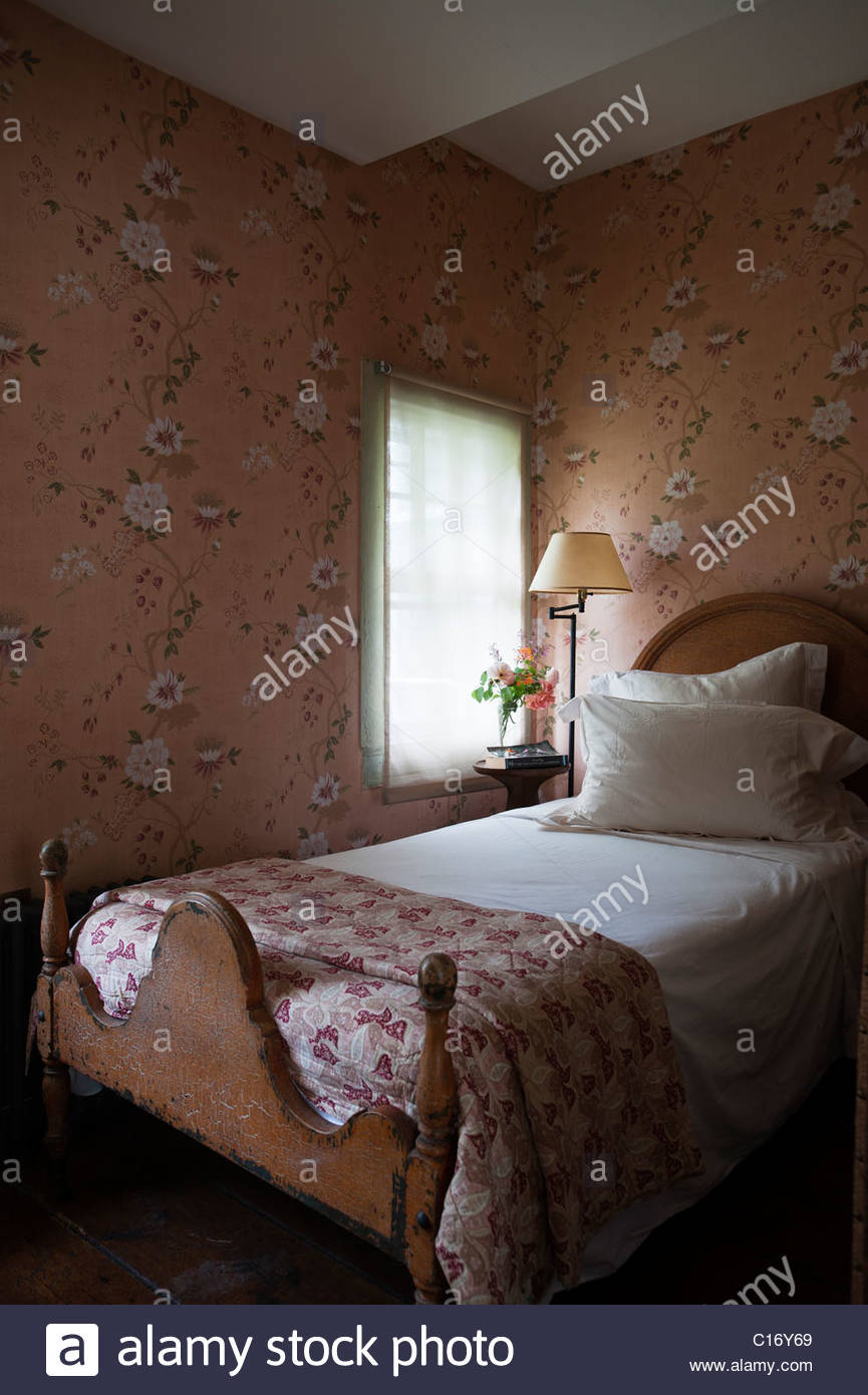 Single bed in 1830s Hudson Valley farmhouse bedroom with patterned 865x1390