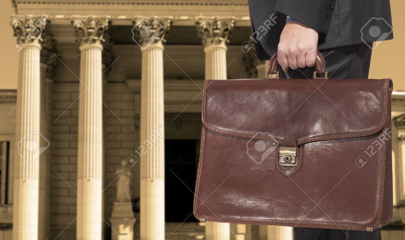 A Lawyer With A Briefcase On The Background Of The Courthouse 1300x770