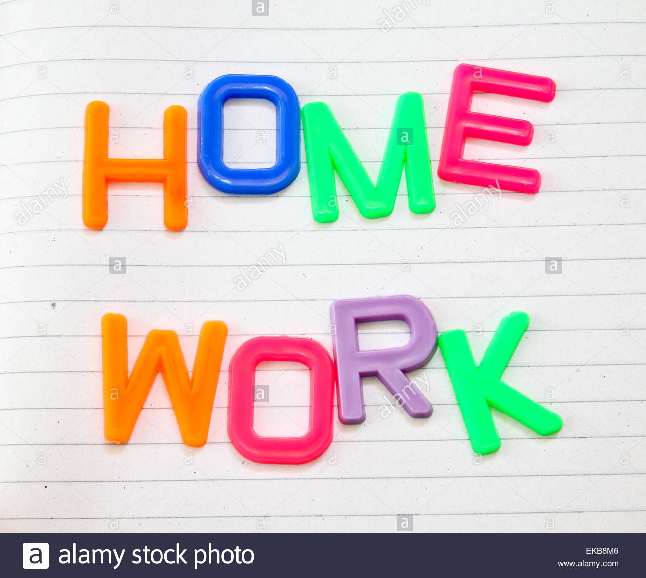 Homework in colorful toy letters on lined paper background Stock 1300x1163