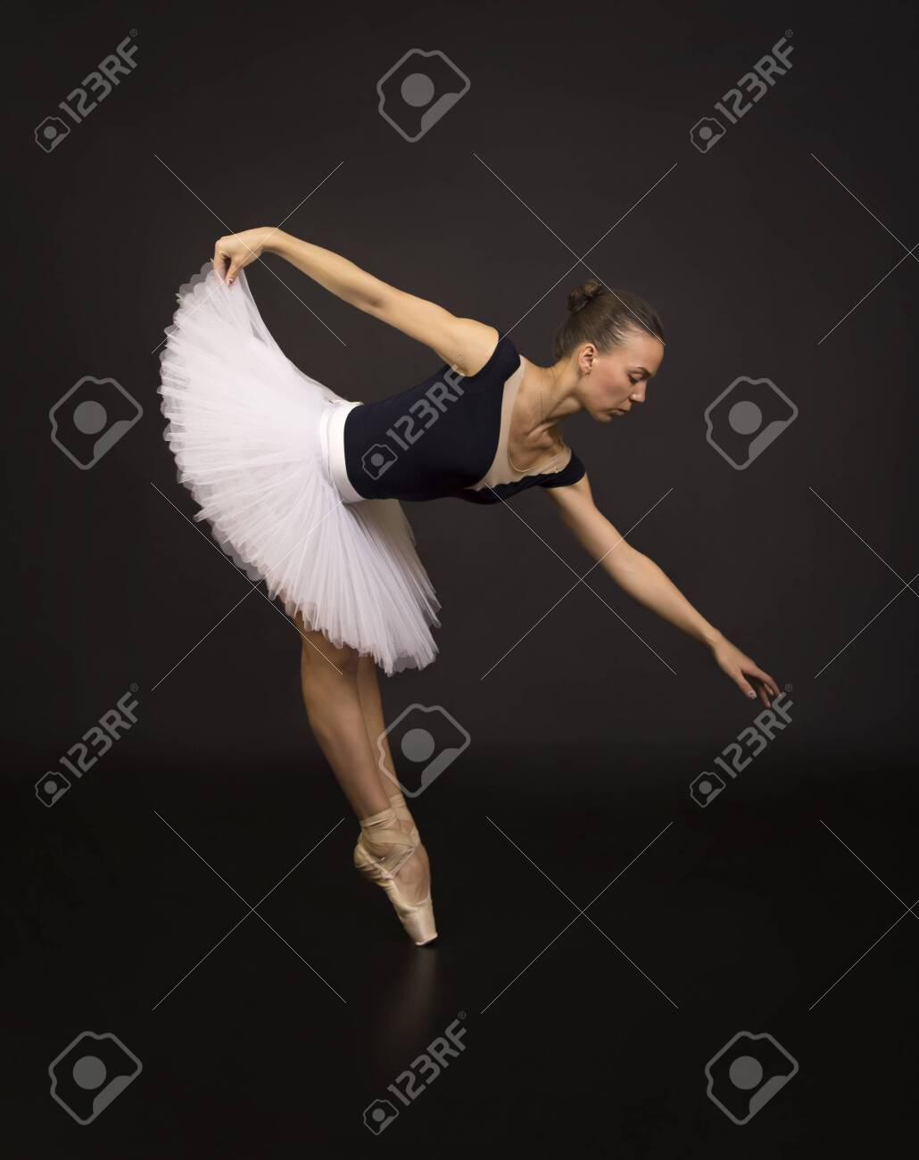 Gorgeous Ballerina In A White Tutu Dancing Ballet Studio Shooting 1030x1300