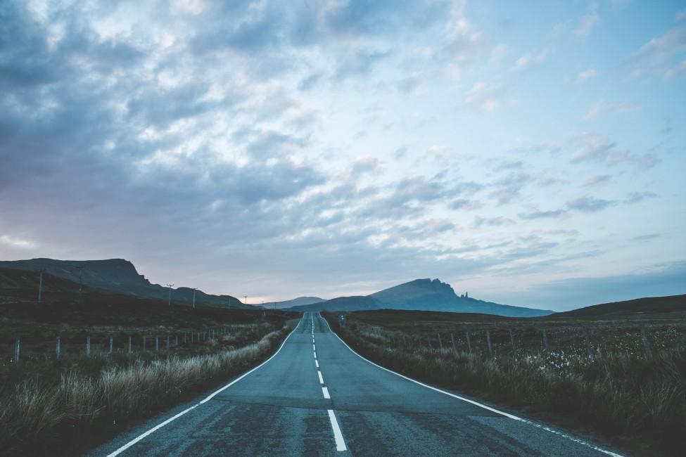 Road Marking Mountains Portree United Kingdom   Stock Photo 975x650