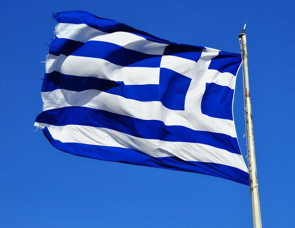 greek flag waving in the air 1024x791