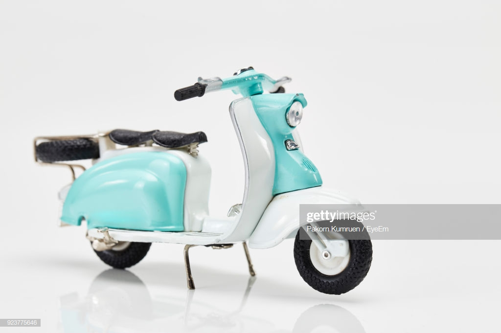 Turquoise Toy Scooter Against White Background Stock Photo   Getty 1024x682