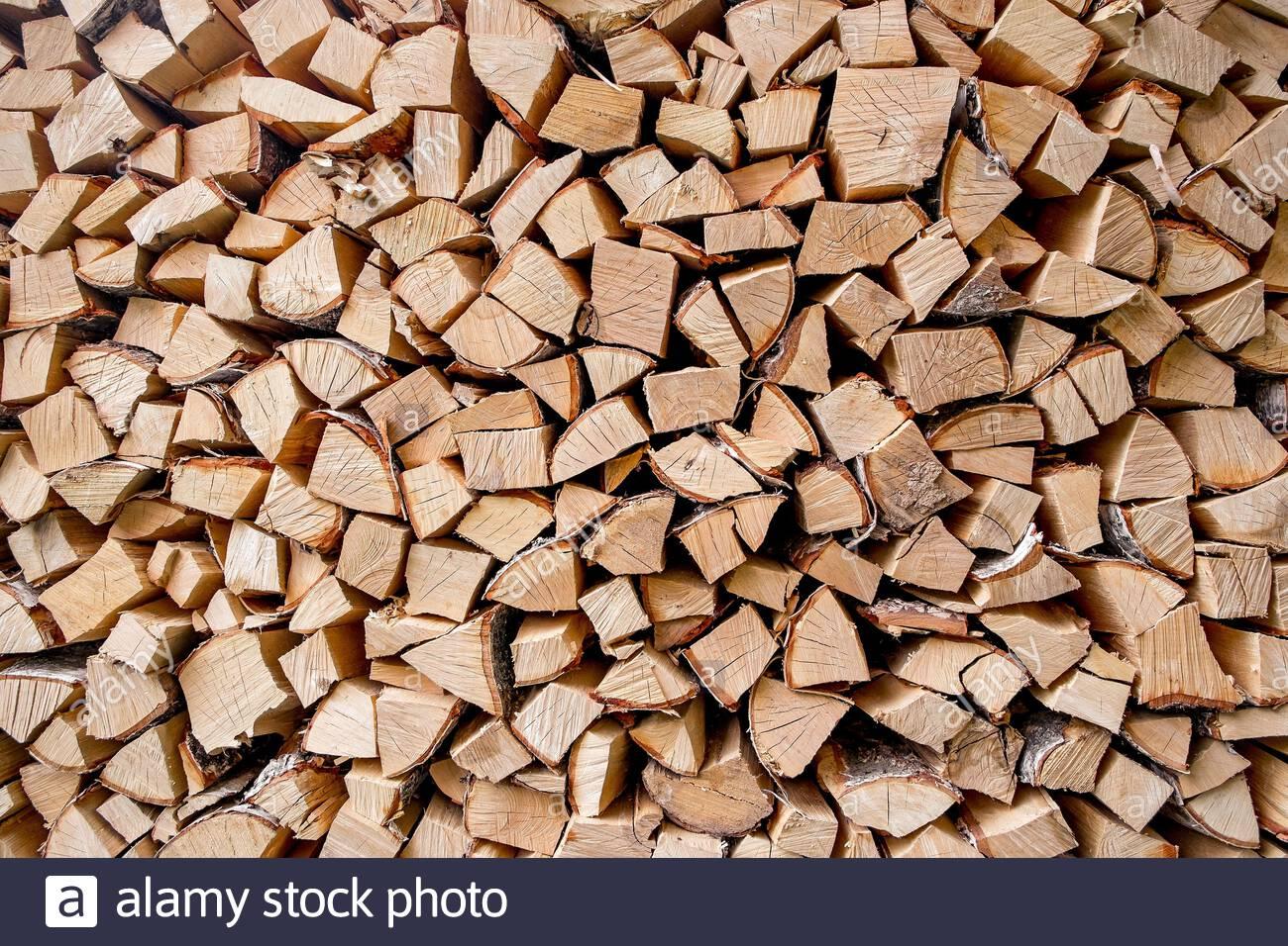A lot of firewood background Stock Photo 337683008   Alamy 1300x956
