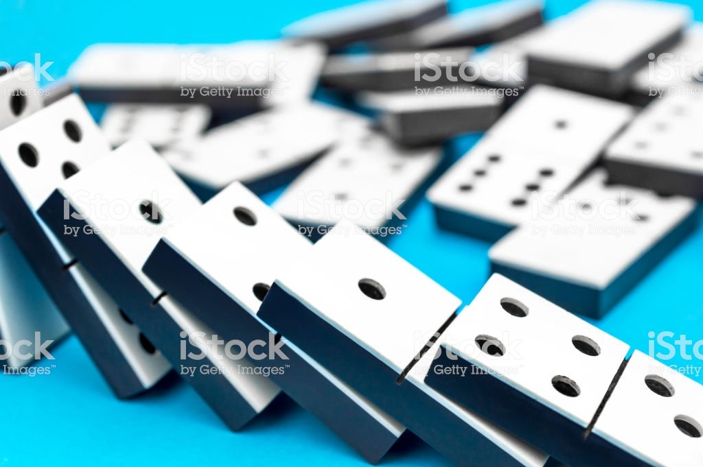 Dominos Pieces On A Blue Background Stock Photo   Download Image 1024x681