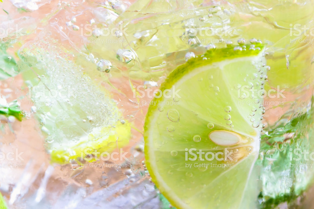 Close Up Concept On Piece Of Lemon Or Lime In Lemonade For 1024x682