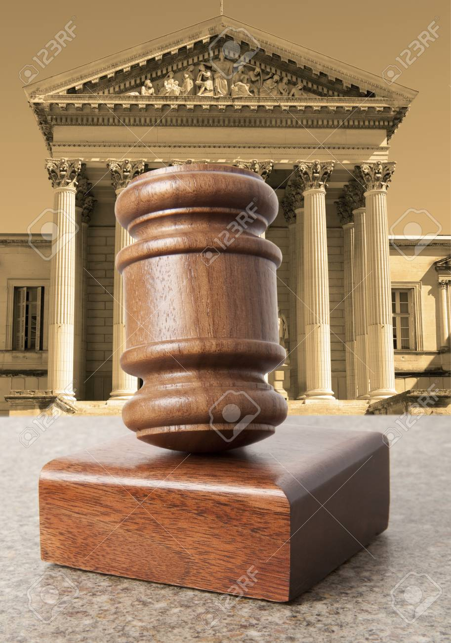 Gavel Against The Background Of The Courthouse Stock Photo 913x1300