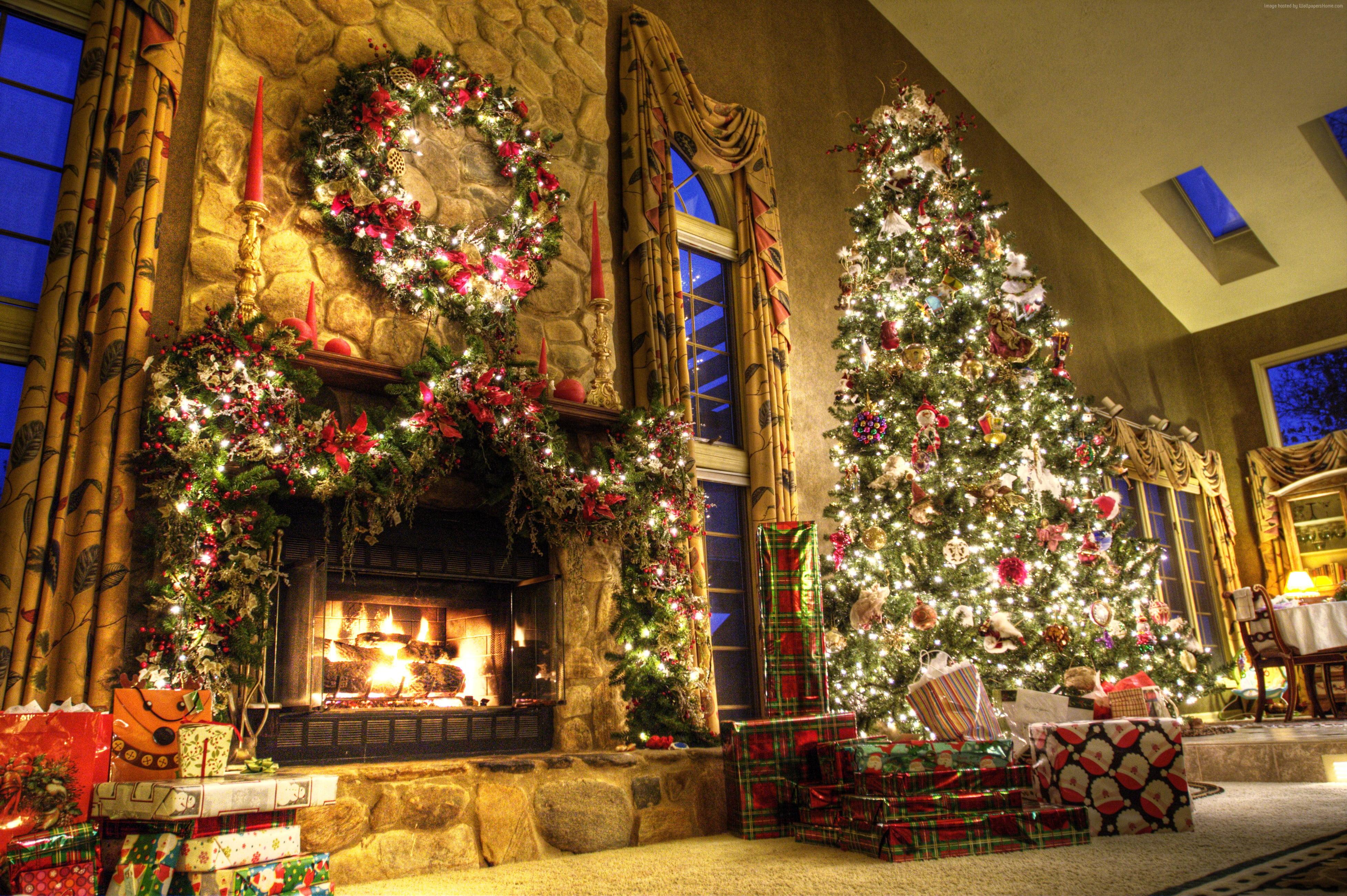 Lighted green Christmas tree near lighted fireplace HD wallpaper 3908x2602