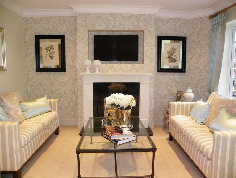 beige living room lounge with feature wall wallpaper and coffee table 800x601