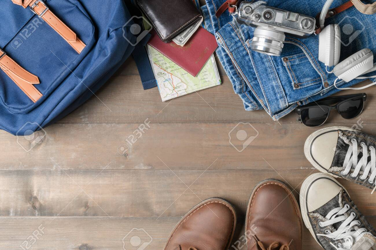 Prepare Backpack Accessories And Travel Items On Wood Background 1300x866