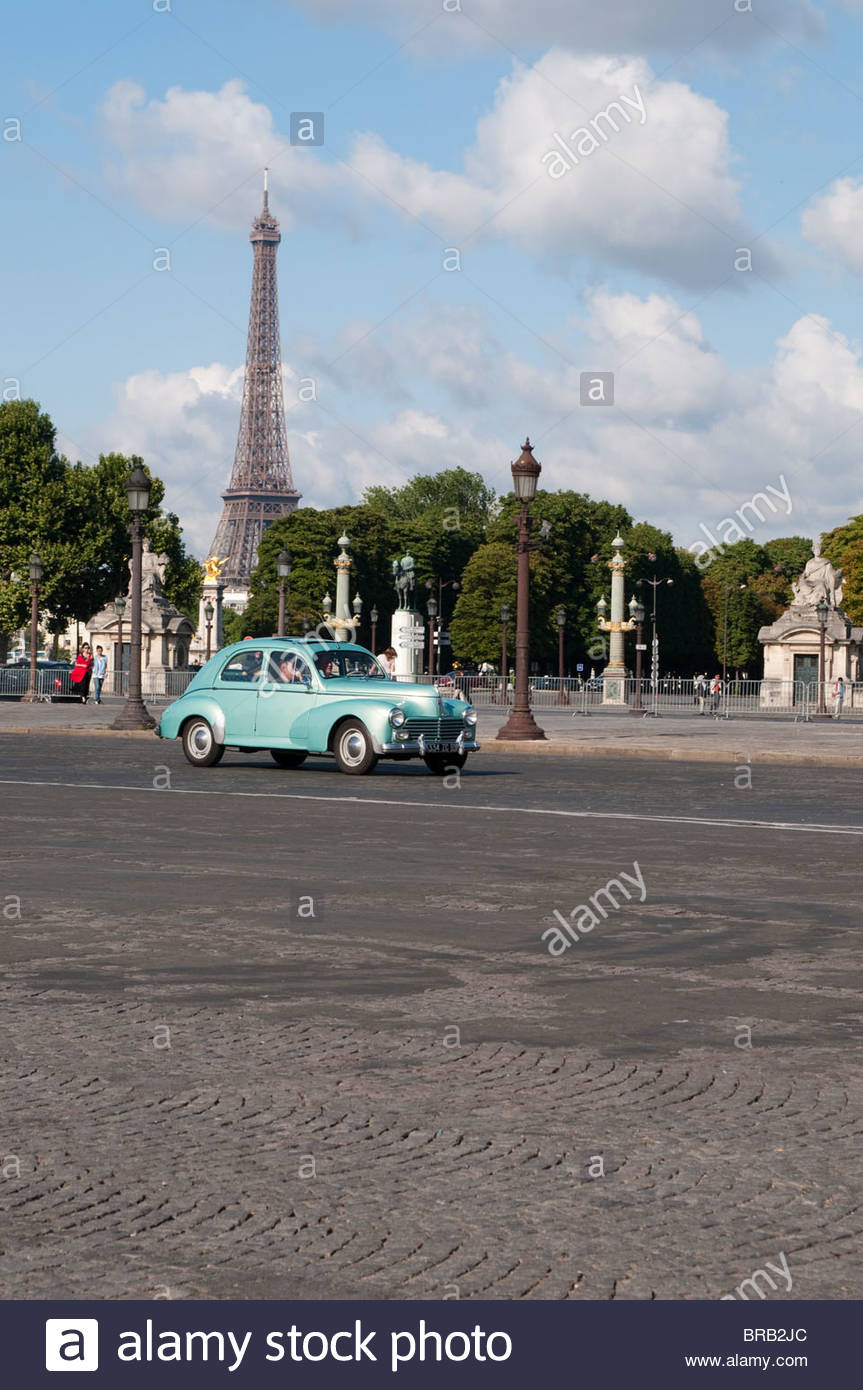 Vintage car on Place de la Concorde with Eiffel Tower in the Stock 863x1390
