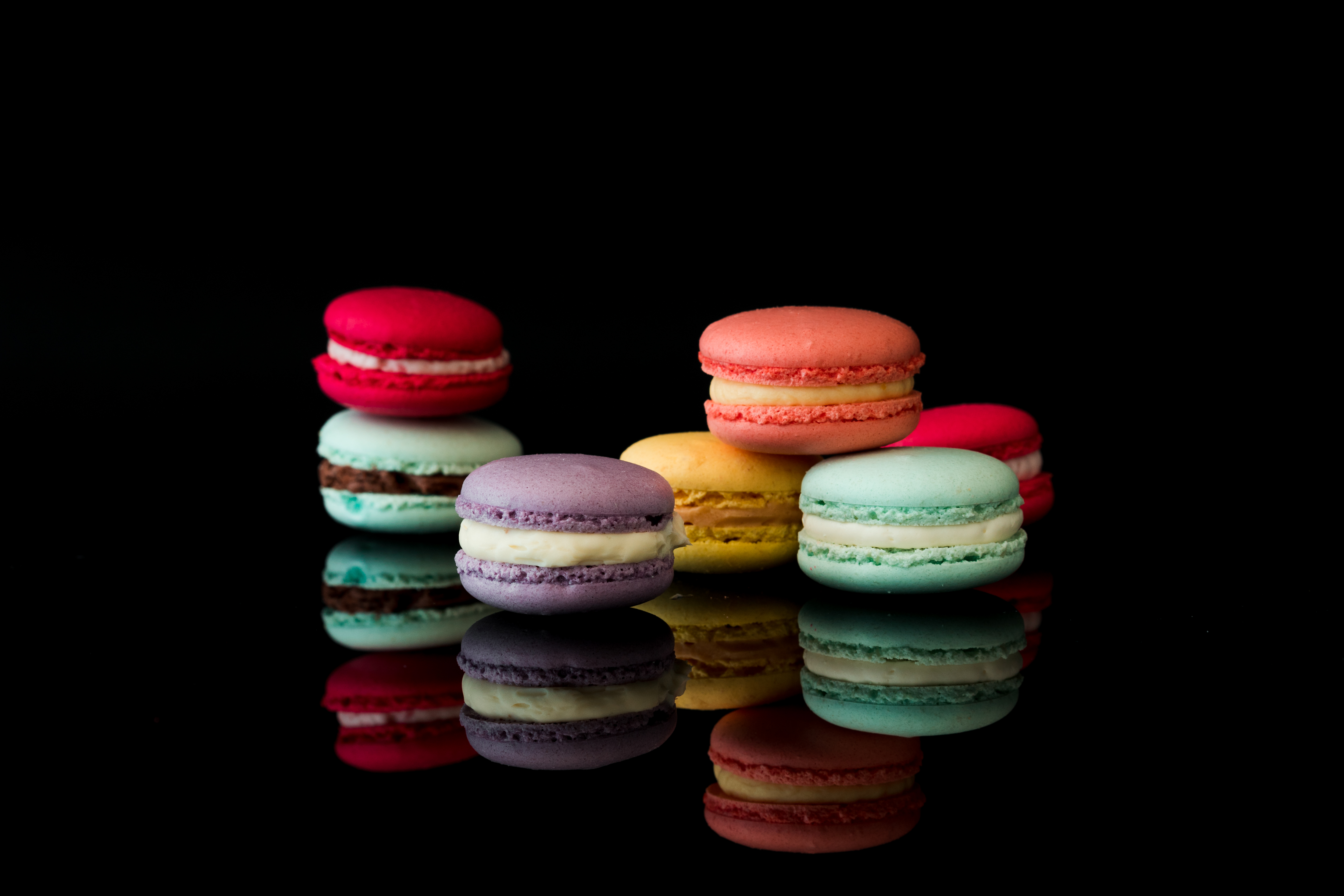 Yummy Macarons on Black Glossy Background Isolated Stock 5000x3333
