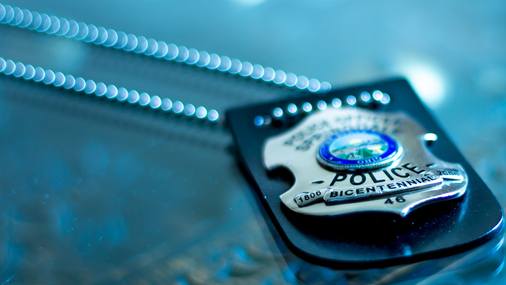 police badge text chain macro wallpaper background 1920x1080