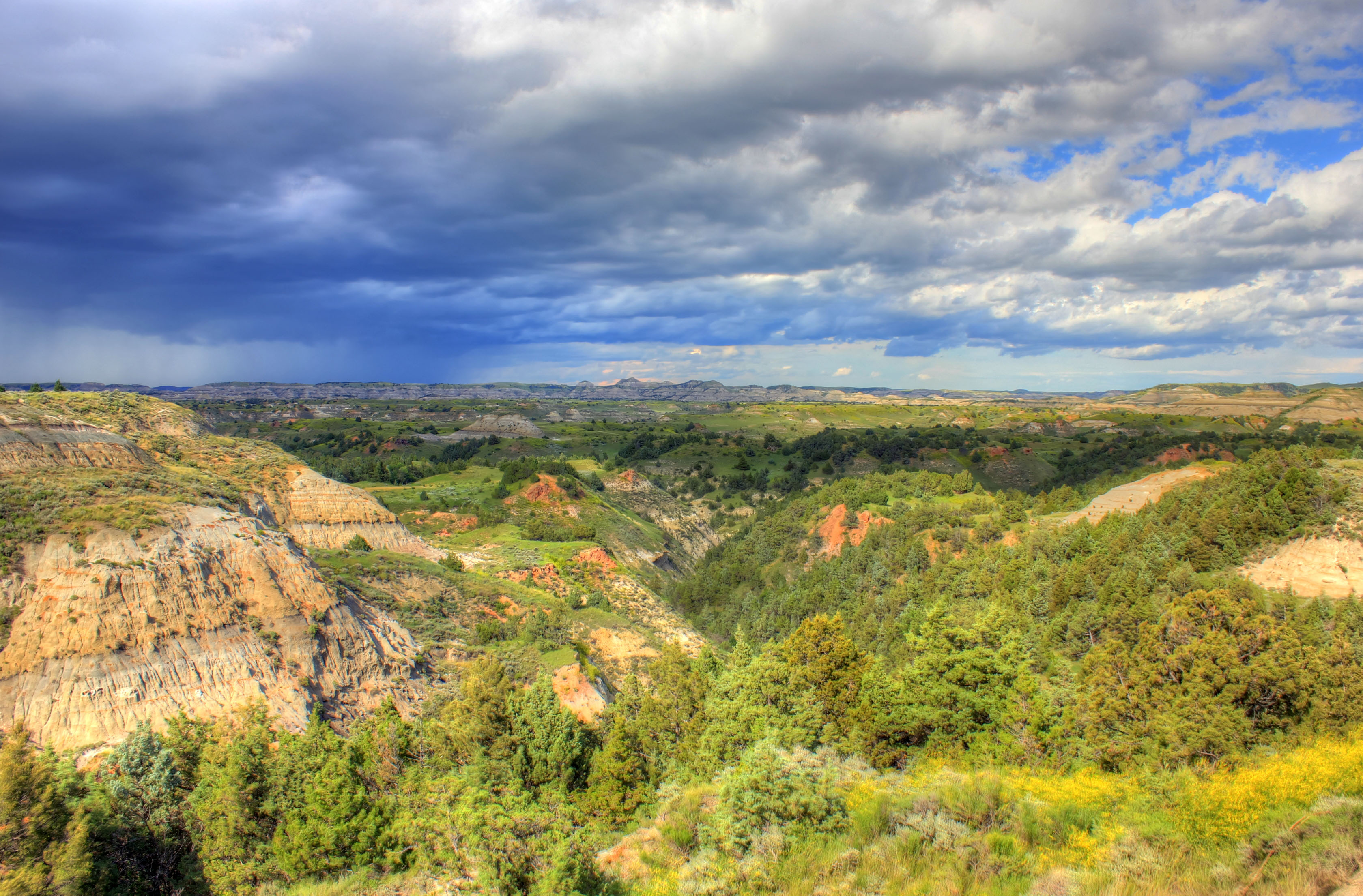 Rain in the distance at Theodore Roosevelt National Park North 3360x2210