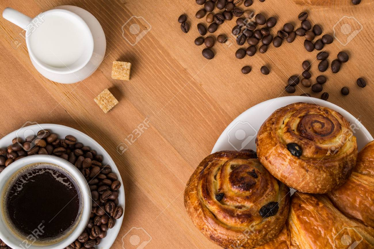 Coffee Cup With Cinnabon And Croissant On Wooden Background 1300x866
