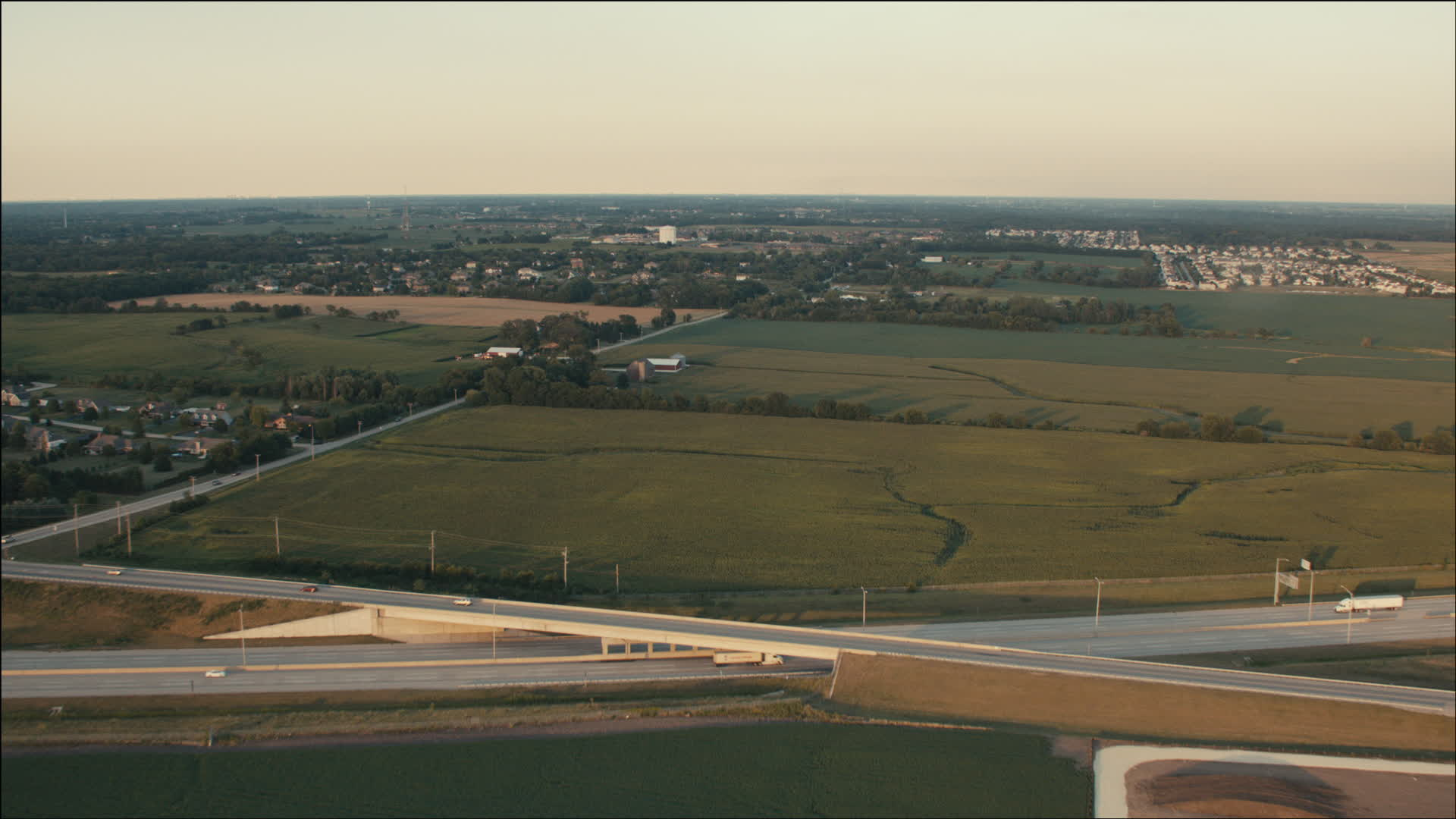 HD stock footage aerial video of flying over freeway and farm 1920x1080