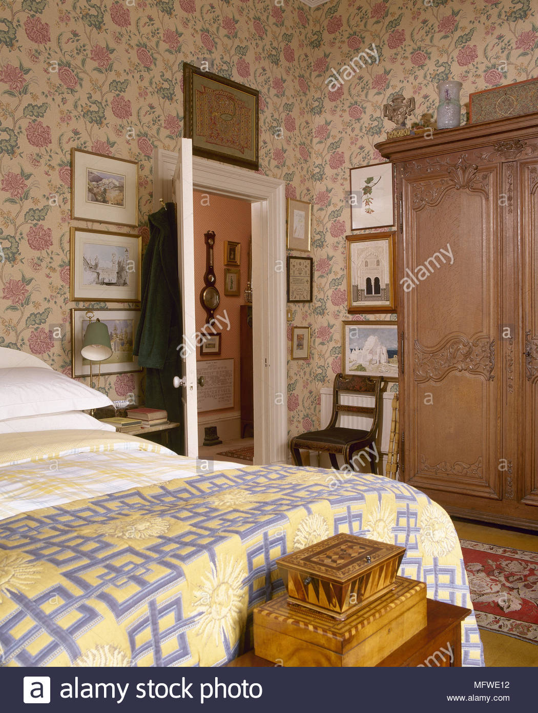 Pink bedroom with floral wallpaper double bed and standing 1050x1390