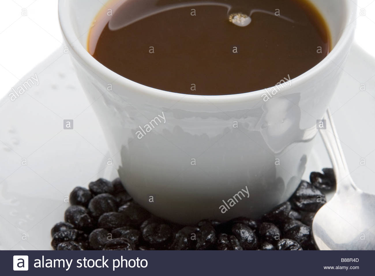 Cup of expresso coffee on a over white background Stock Photo 1300x956