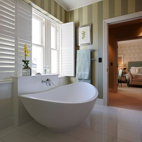 White en suite bathroom with green stripe wallpaper 550x550