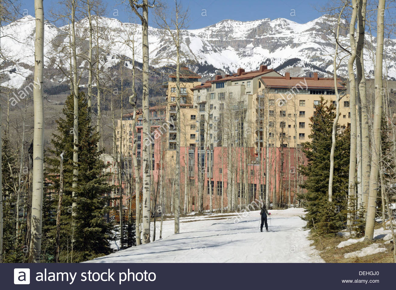 Woman skiing in Telluride Colorado Wyndham hotel in the Stock 1300x954